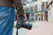 Photographer with camera in the city — Stock Photo
