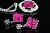 Pink Colored Jewelry Set with Earrings in focus — Stock Photo