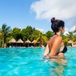 Stock Photo: Latin Girl Having a Bath in a Tropical Pool