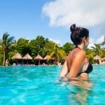 Latin Girl Having a Bath in a Tropical Pool — Stock Photo