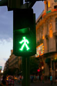 Green Pedestrian in traffic light at night — Stock Photo