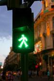 Green Pedestrian in traffic light at night — Stock Photo