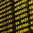 Stock Photo: Flights information board in airport terminal