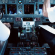 Airliner Cockpit with Pilots Working - Stock Photo