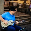 Street Musician Playing Blues in the Streets of Puerto de la Cru - Stock Photo