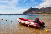 Red Lifeboat in the beach — Stock Photo