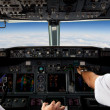 Pilots Working in an Aeroplane - Stock Photo