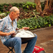 Stock Photo: Street MusiciPlaying Traditional Instrument called Hang