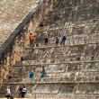 Maintenance workers in Chichen Itza Pyramid - Stock Photo