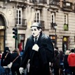 Постер, плакат: Street Performer Dressed as Charlie Chaplin