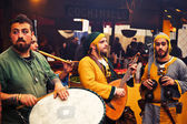 Musicans playing during street concert — Stock Photo