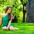 Beautiful Teenager Smiling Sitted on Grass — Stock Photo #25908181