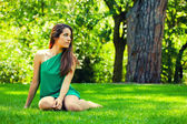 Beautiful Teenager Smiling Sitted on the Grass — Stock Photo