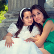 Two sisters in the First Communion Day — Stock Photo #27911655