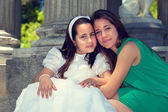 Two sisters in the First Communion Day — Stock Photo