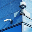Постер, плакат: Security Camera in a Modern Building
