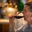 Tourist drinking wine in the famous San Miguel Market, Madrid — Stock Photo #29758251