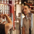 Tourist ordering a beer in the famous San Miguel Market, Madrid — Stock Photo