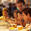 Tourists eating tapas the famous San Miguel Market, Madrid — Stock Photo