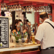 Tourist in San Miguel Market ordering a Beer — Stock Photo #29988709