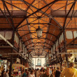 Tourist visiting the famous San Miguel Market in Madrid, Spain — Stock Photo #29988753