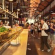 Tourists visiting famous SMiguel Market, Madrid — Stock Photo #29988755
