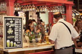 Tourist in San Miguel Market ordering a Beer — Stock Photo