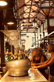 Tourists eating tapas in the famous San Miguel Market, Madrid — Stock Photo