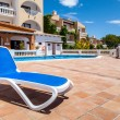 Deck Chair in a Swimming Pool — Stock Photo
