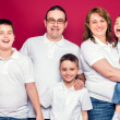 Five Member Family Smiling — Stock Photo #34182235