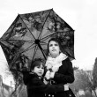Children with umbrella — Photo