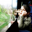 Little girl and boy travel on a train — Stock Photo #24681473
