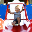 Little boy on the slide — Stock Photo