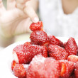 Closeup child's hand with strawberries — Stock Photo