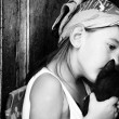 Little girl kissing her cat — Stock Photo