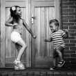 Stock Photo: Sister and brother dancing