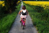 Young girl outdoors on bicycles — Stock fotografie