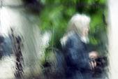 Senior woman in the rain — Stock Photo