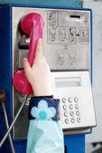 Little girl in public telephone — Stock Photo
