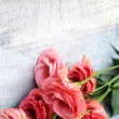 Flowers on wooden background — Foto Stock