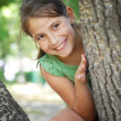 Girl sitting on the tree — Stock Photo