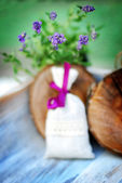 Lavender bag and some fresh lavender flowers on at wooden box — Stock Photo