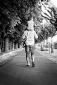Man with son walking and holding hands — Stockfoto