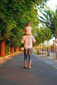 Man with son walking and holding hands — Стоковое фото