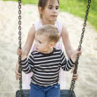 Sister and brother playing at the playground — Stock Photo #40310015