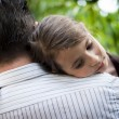 Little Girl resting on her father's shoulder — Stock Photo