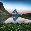 Matterhorn reflection in Riffelsee with flowers, Zermatt, Alps, Switzerland — Stock Photo #35116273
