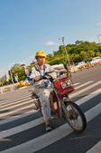 Worker on motocycle — Stock Photo