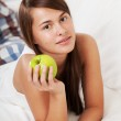Girl with apple — Stock Photo #17165709
