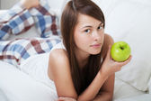 Beautiful young woman with apple — Foto Stock